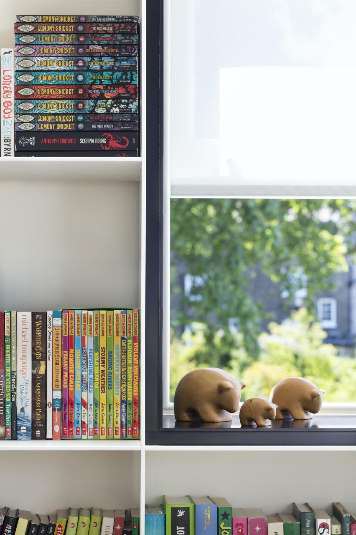 bookshelf located near window