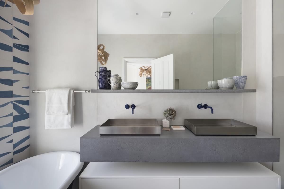 grey concrete washing basin in bathroom