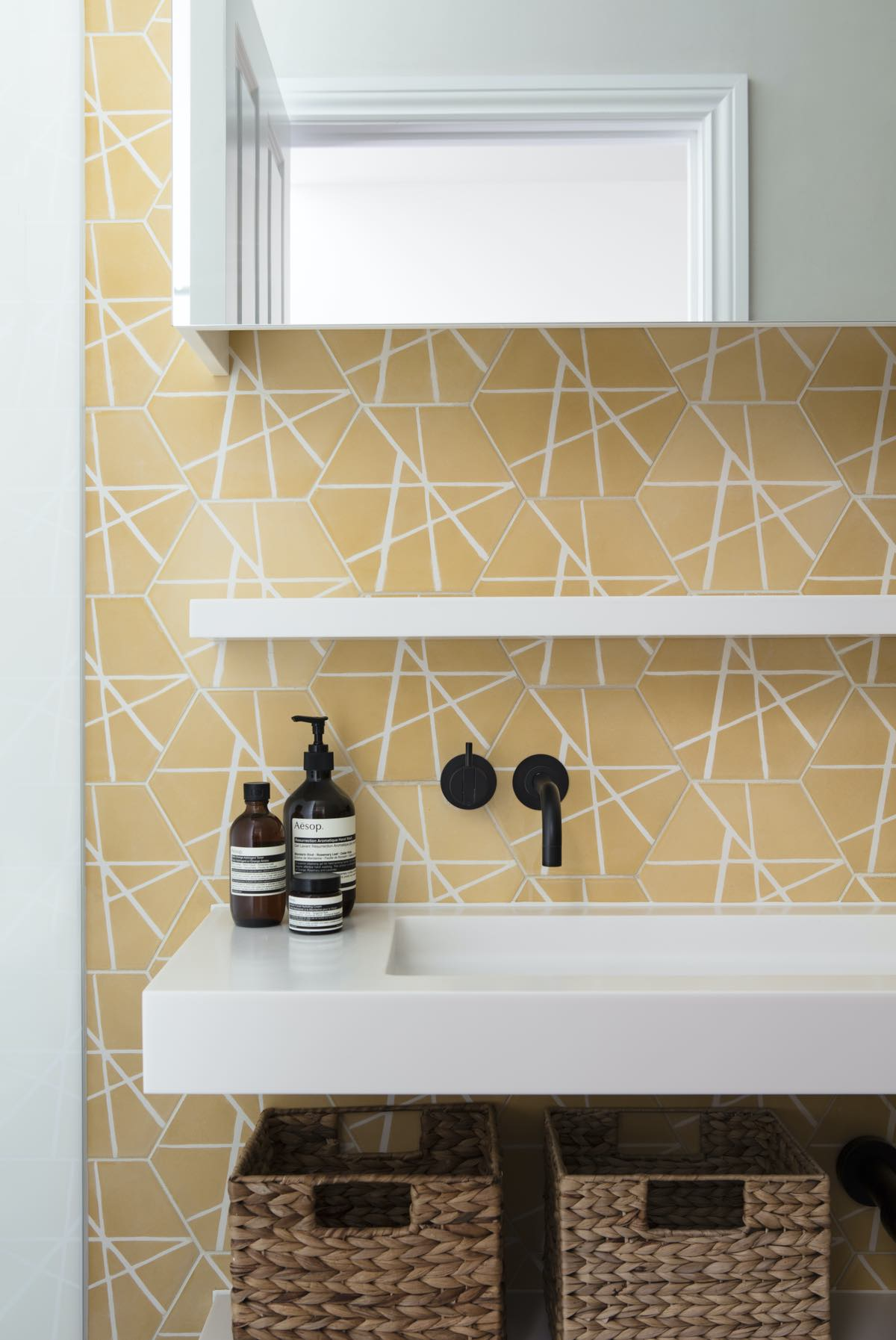 yellow ceramic used for the wall finishing in this bathroom