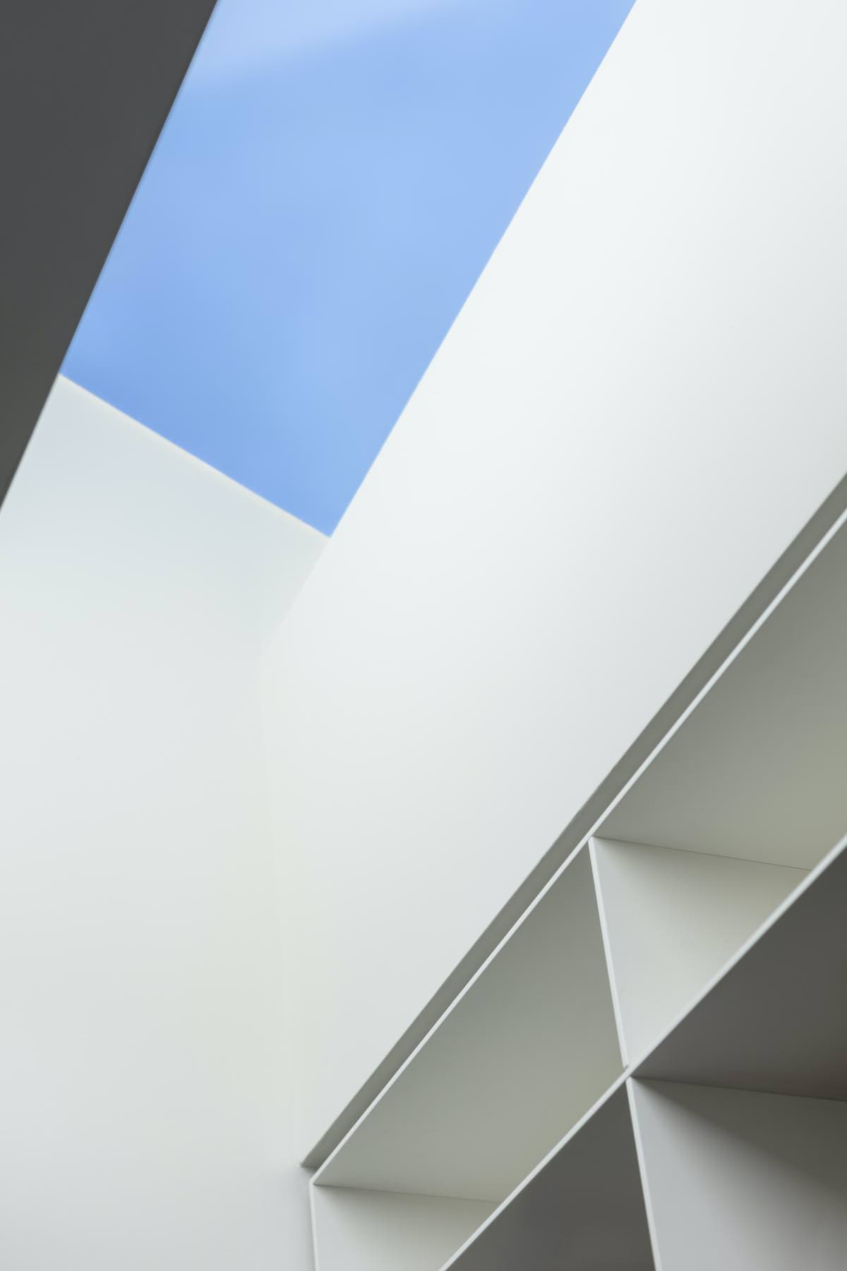 blue sky and white walls