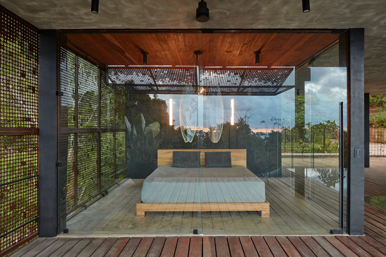 bedroom with glass and screened wall