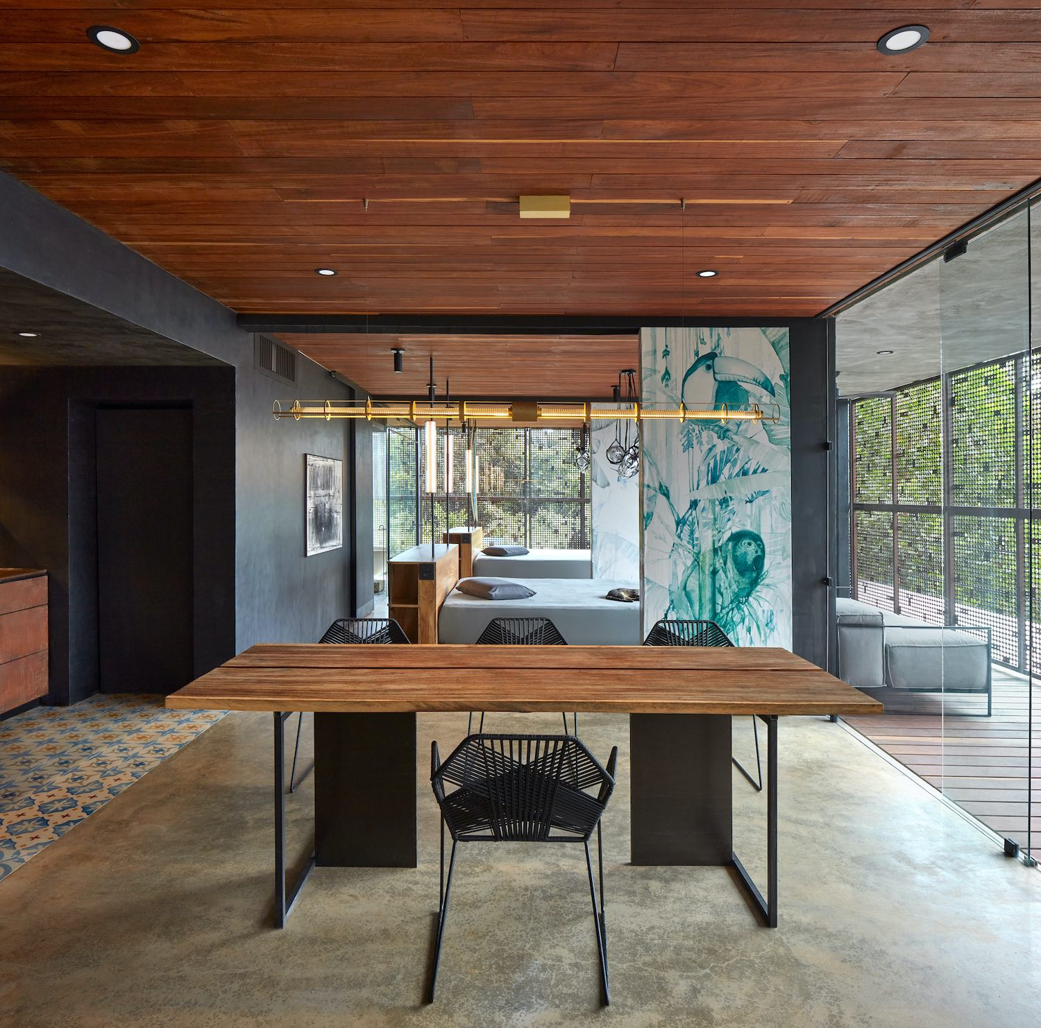 wooden dining table with metallic chairs