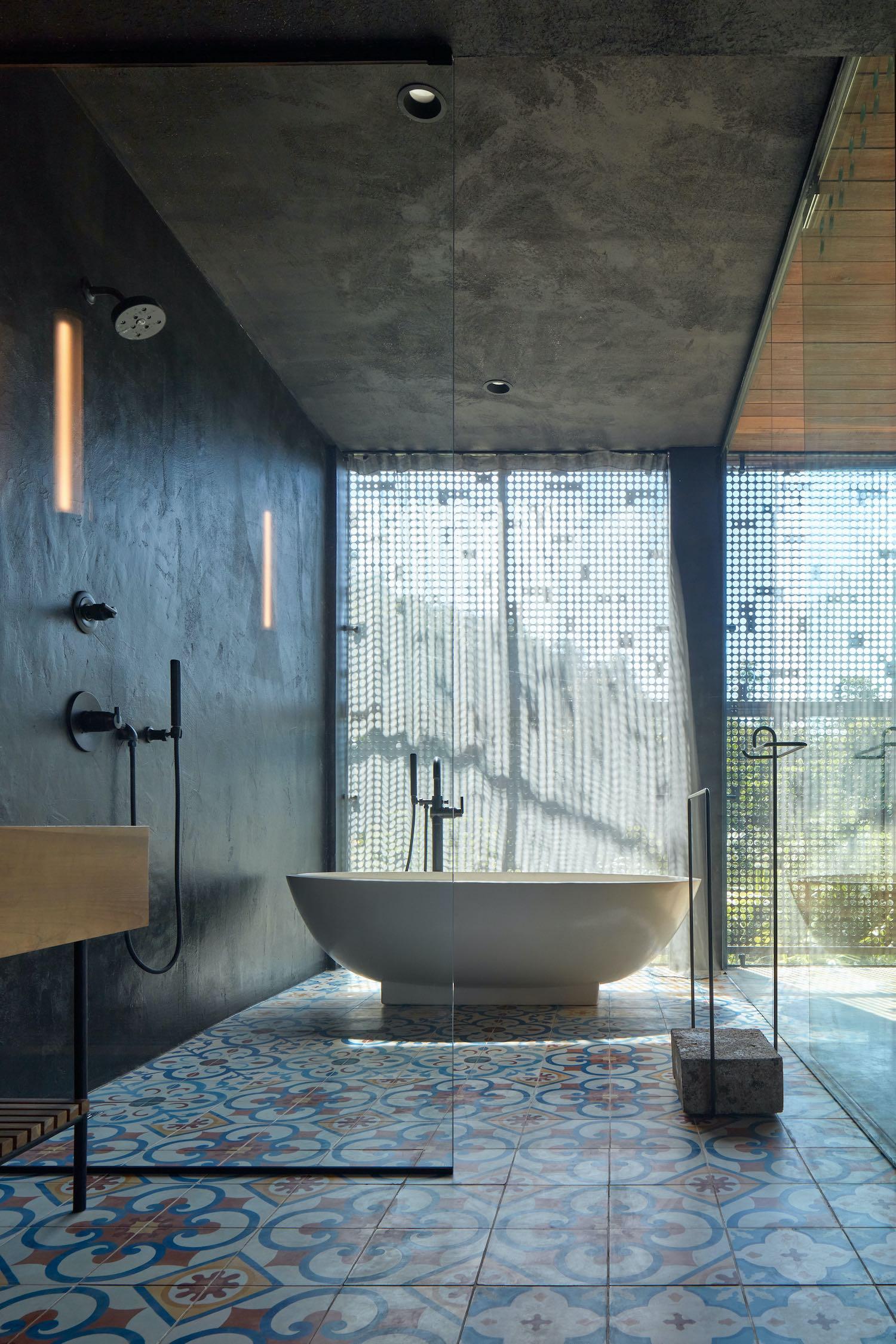 bathtub near windows