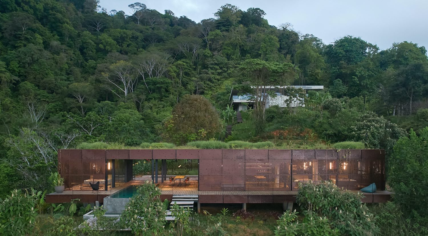 villa in a tropical rainforest surrounded by trees