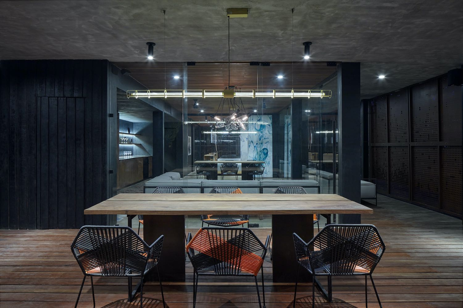 wooden dining table and metallic chairs in kitchen