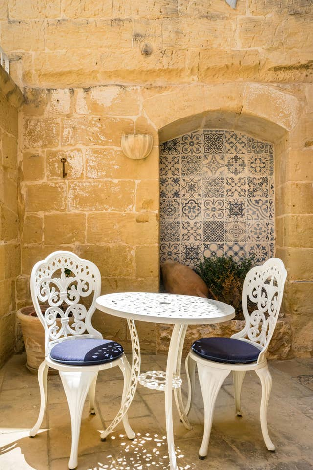 metallic chairs and table at courtyard