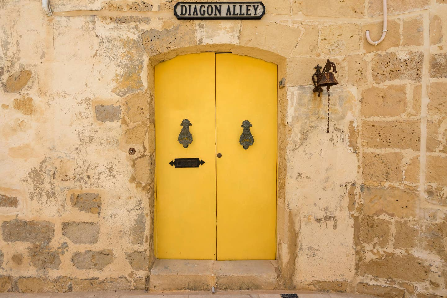 yellow door and stone wall