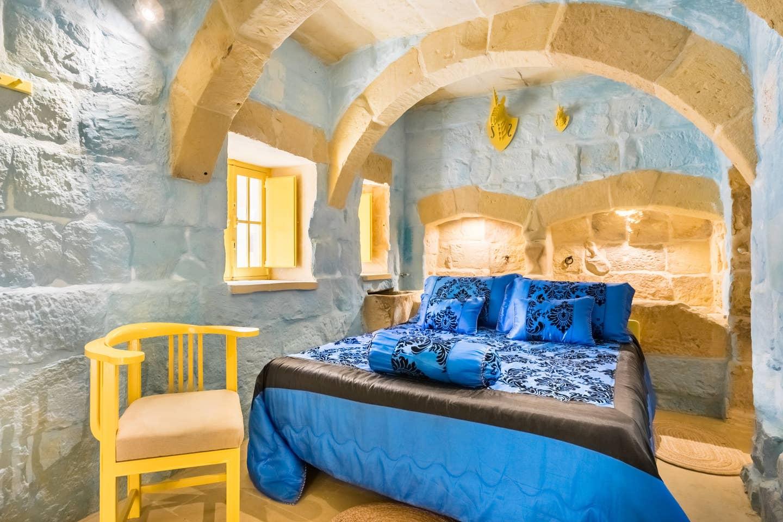 luxury bedroom with stone walls