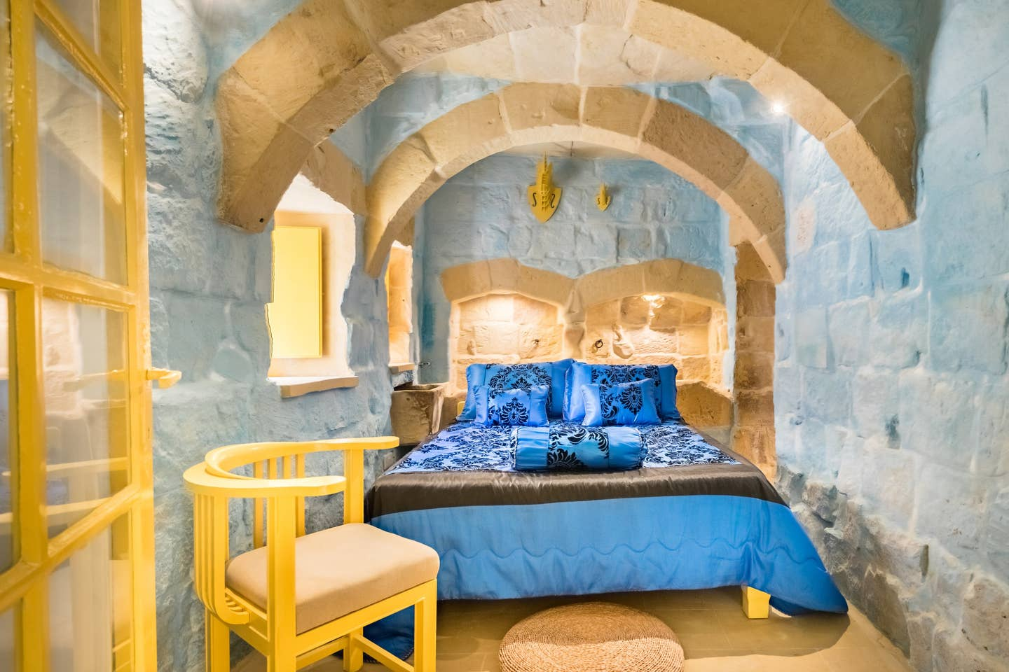 blue bed in a bedroom with blue walls