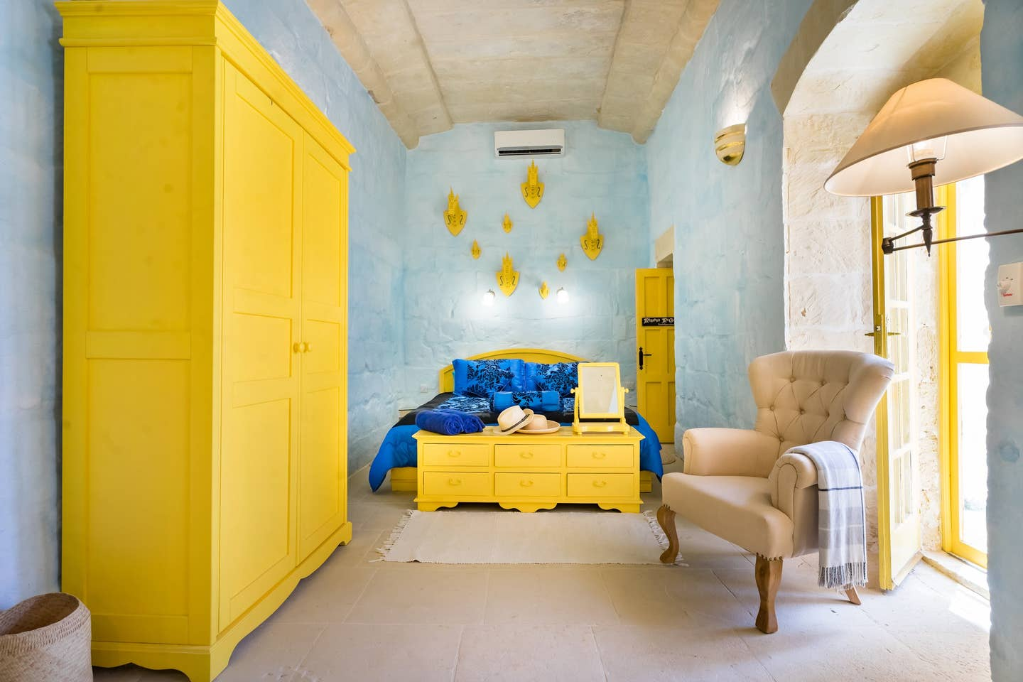 bedroom with yellow wardrobe and drawer
