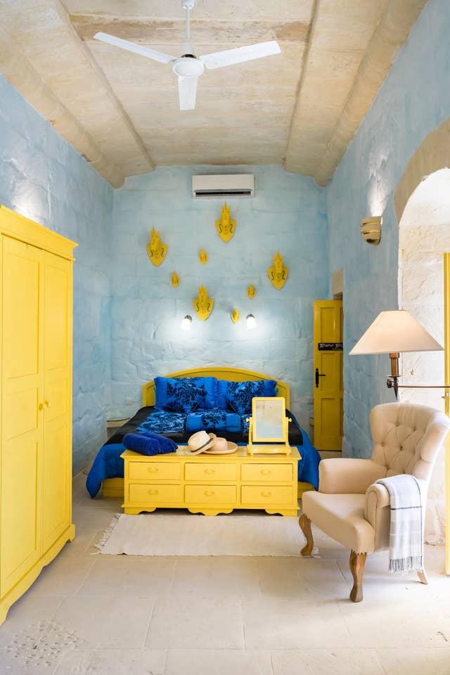 bedroom with yellow wardrobe