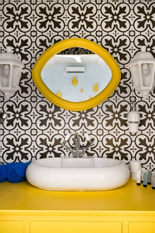 washing basin and mirror with tile walls