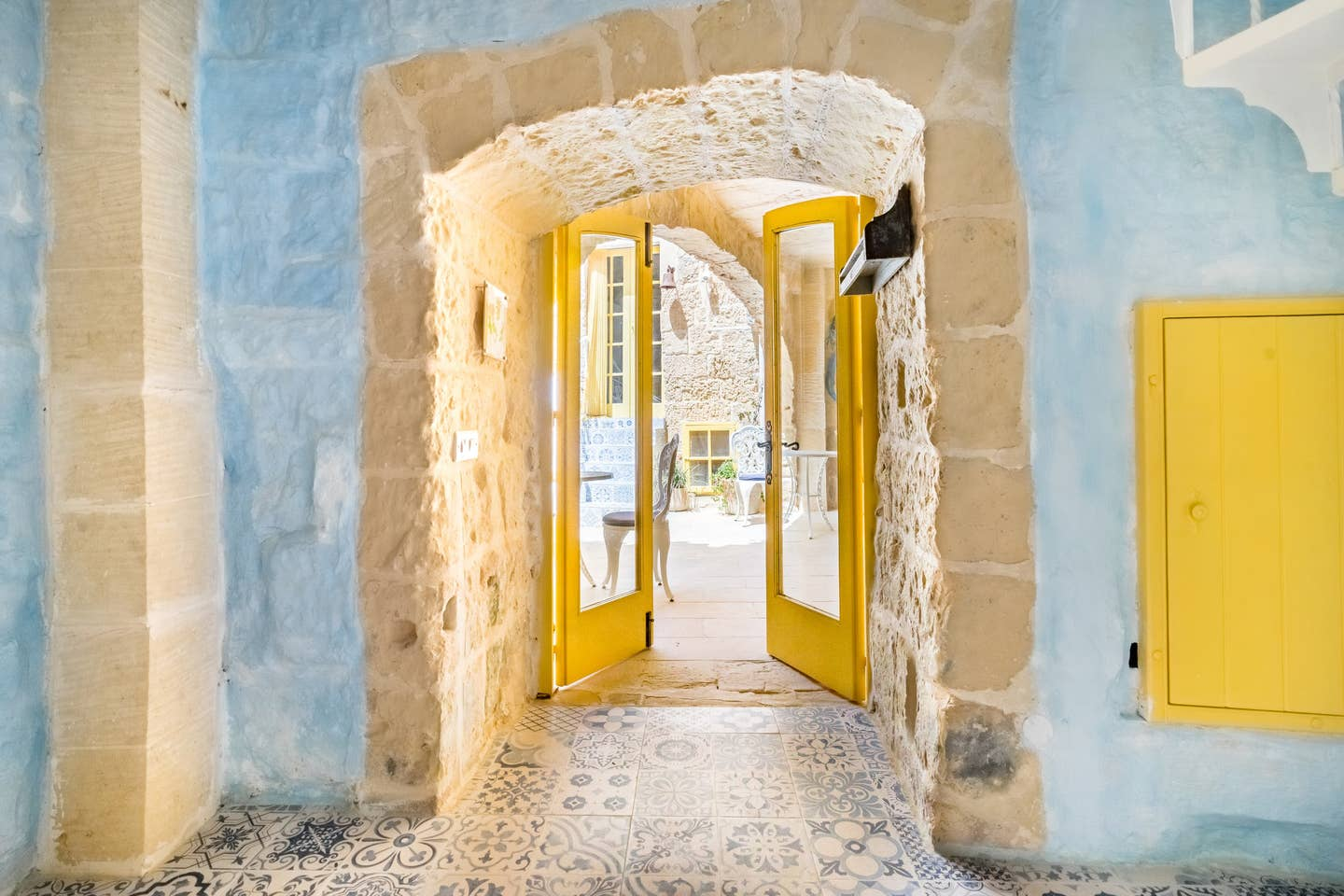 yellow entrance door and colored tiles