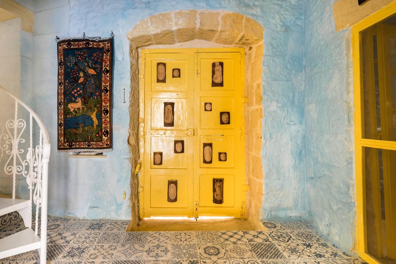 yellow door and floor with tiles