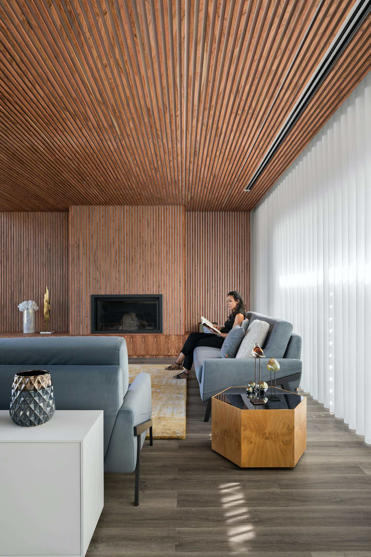 cozy living room with wooden wall