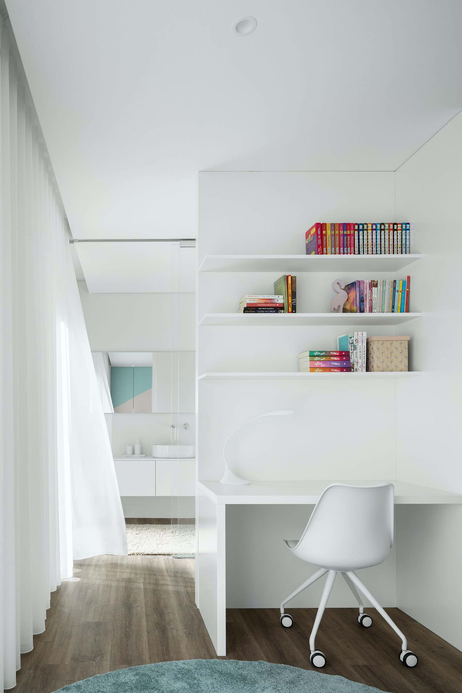 white chair and white bookshelves