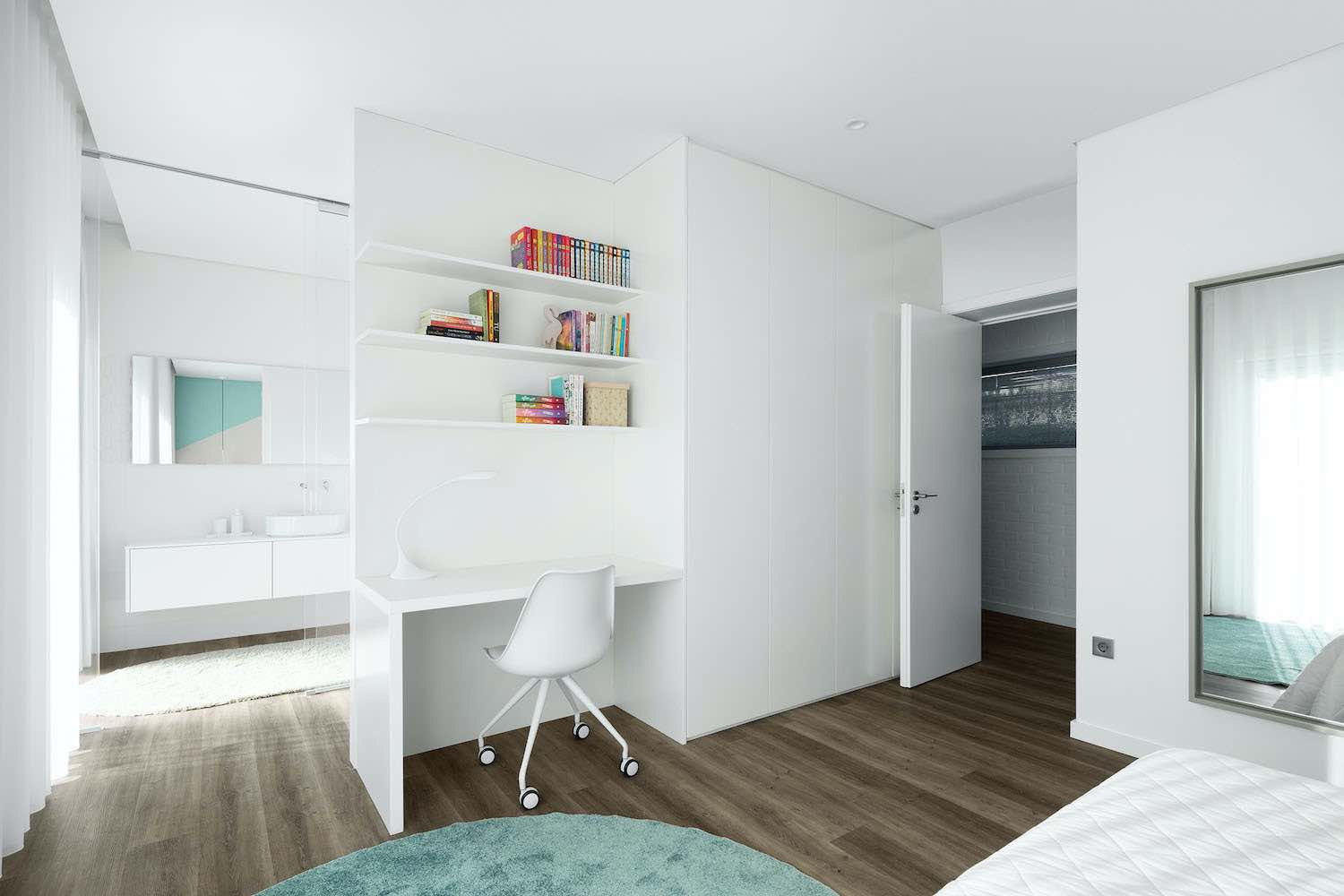 a master bedroom with small desk office