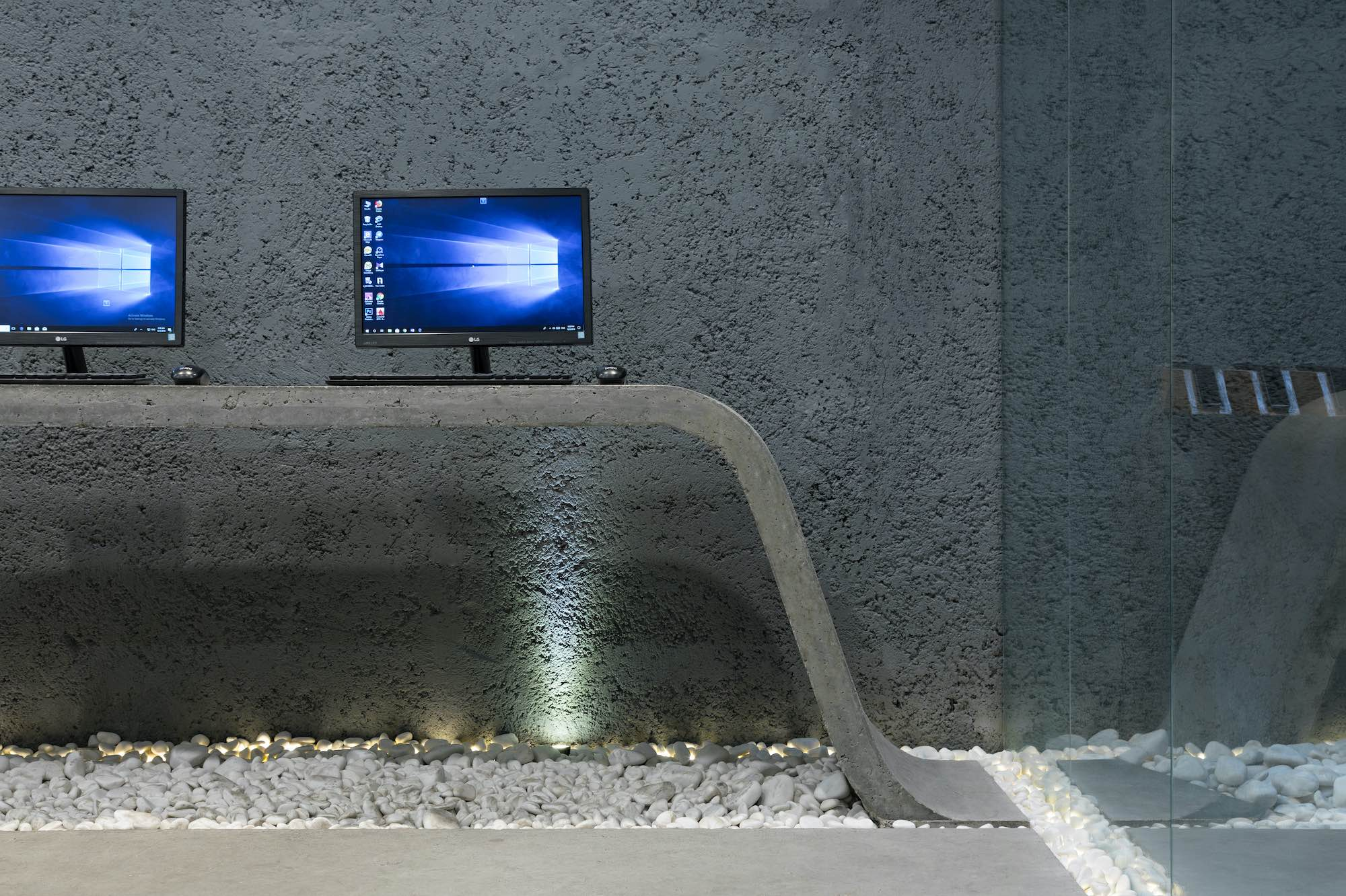 an LG monitor on a concrete office desk