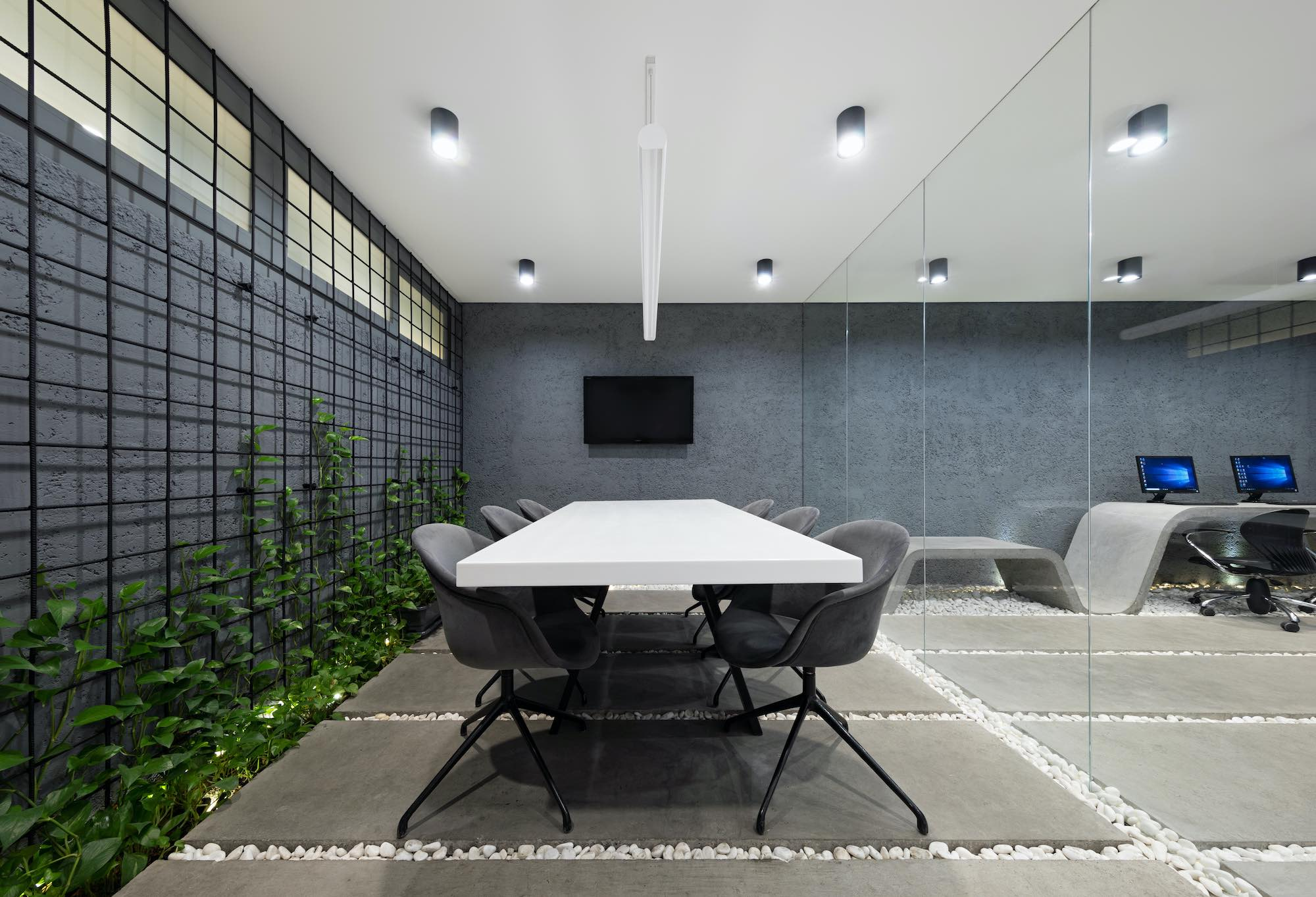 a meeting table on a concrete floor