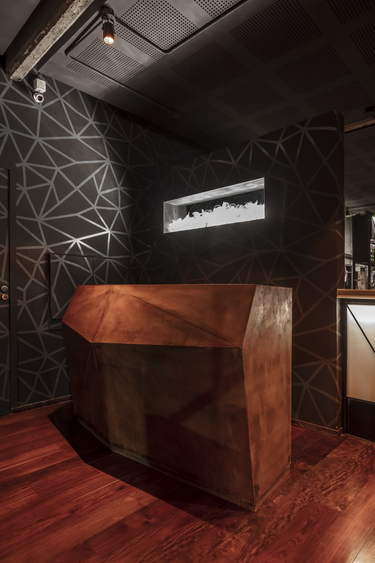 reception desk with black wall