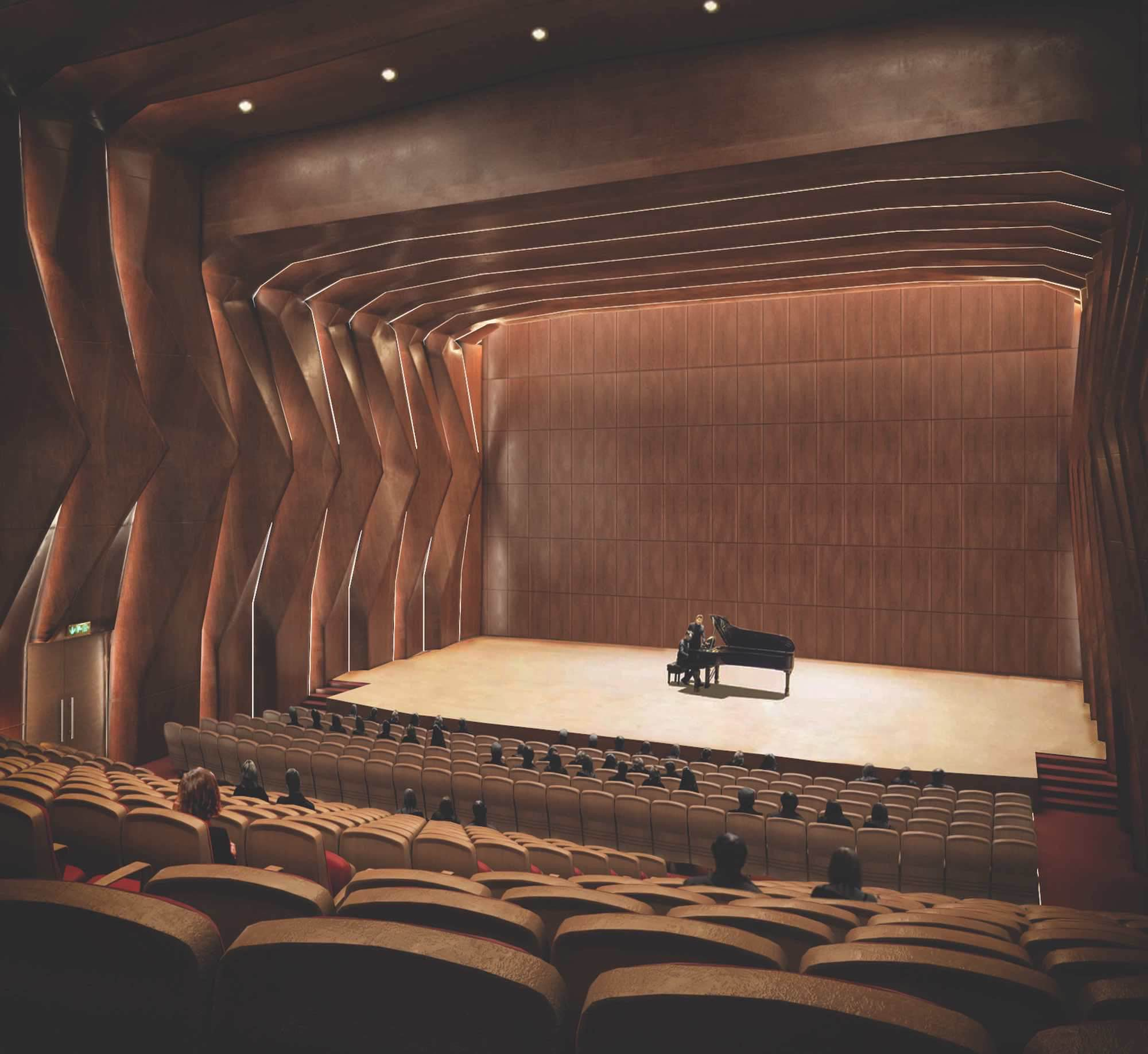 a man playing piano in a theatre