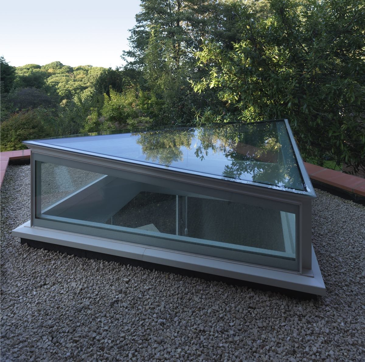 the skylight covered with glass at the roof of the house