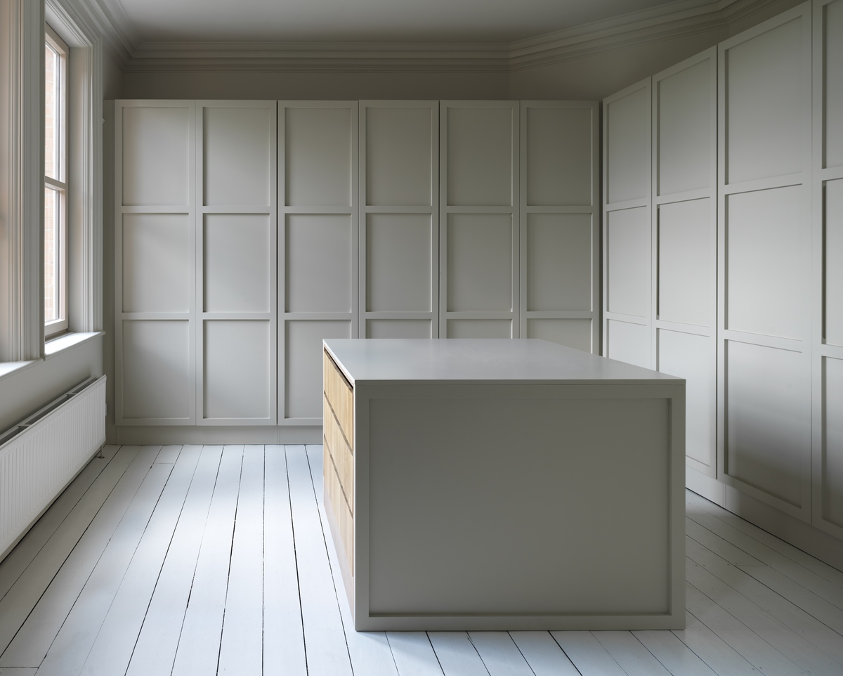 Spacious dressing room with built-in wardrobes