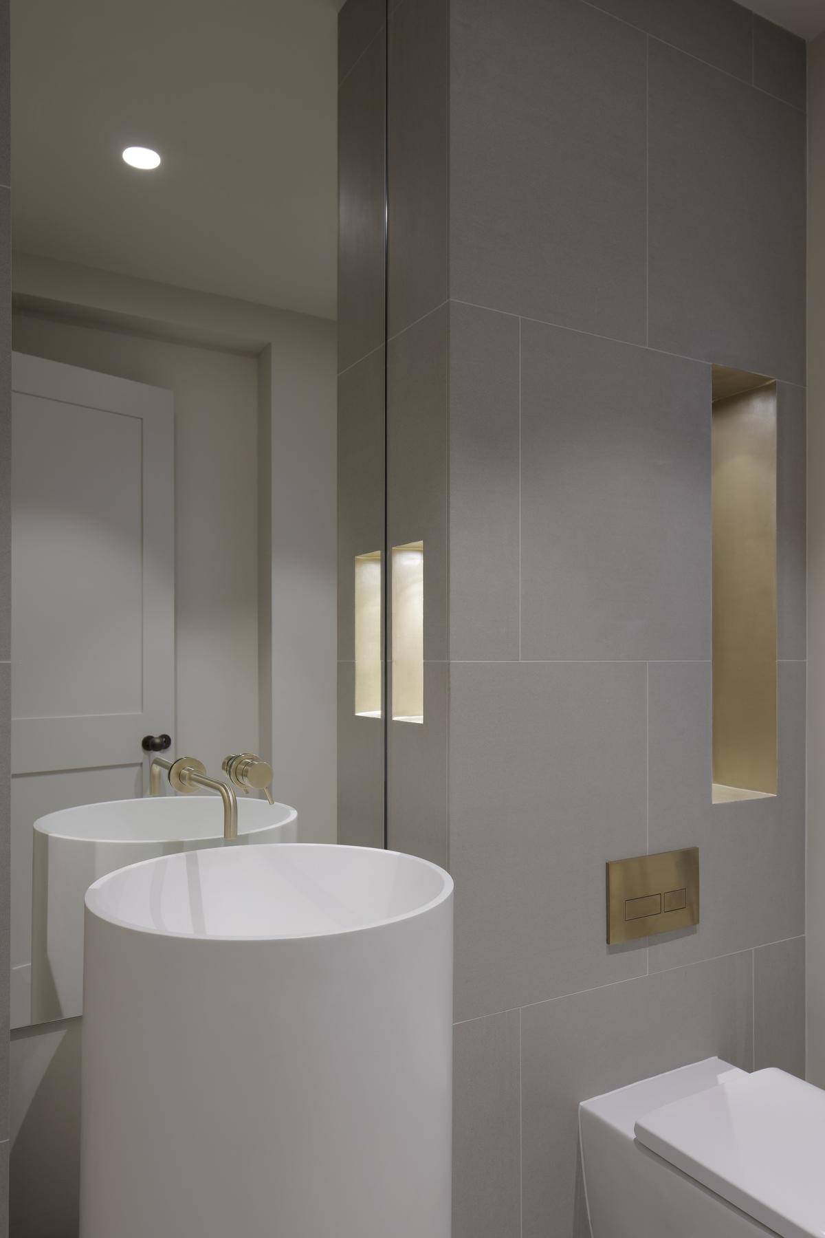 a small white washing basin in bathroom