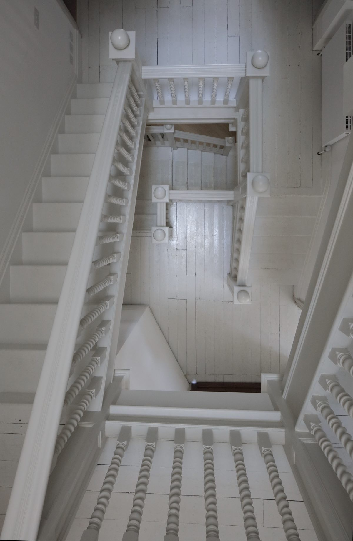 white handrail used for a white staircase in a hot in London