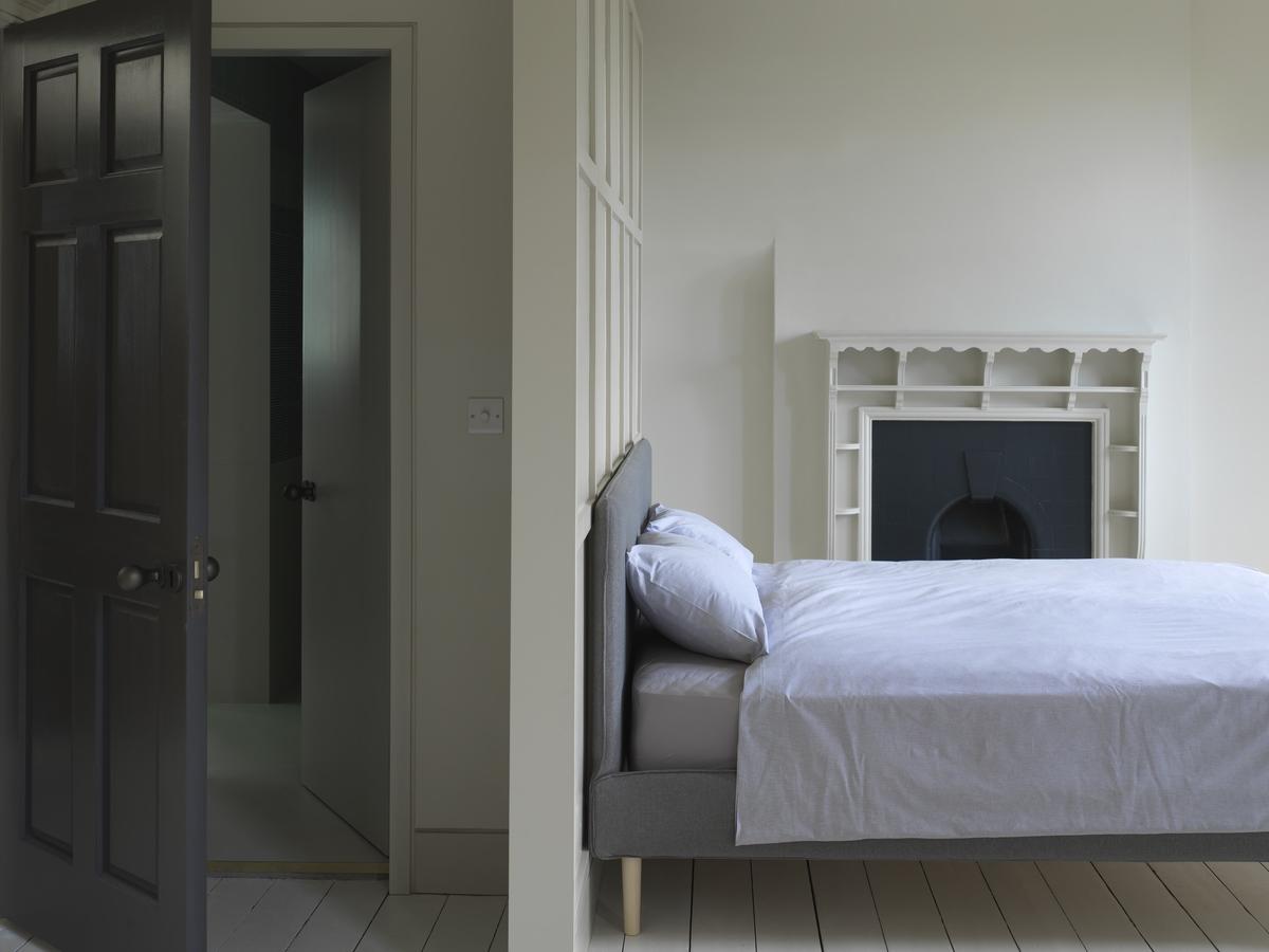 a black wooden door opened in bedroom