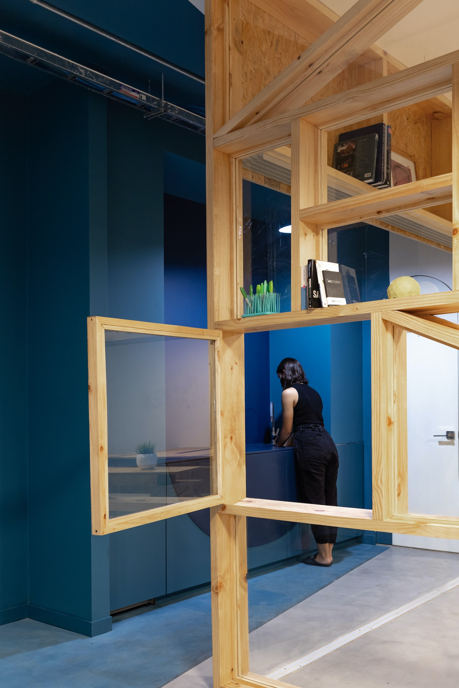 office with blue walls and wooden installation