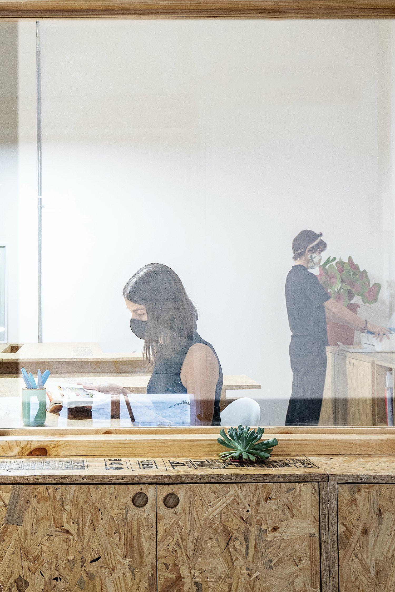 girl wearing black mask workin at office