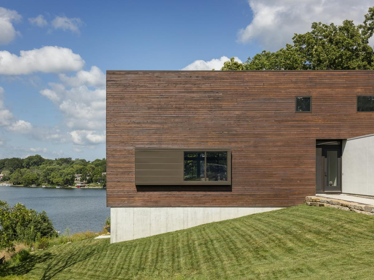 the exterior of home finished with wooden material