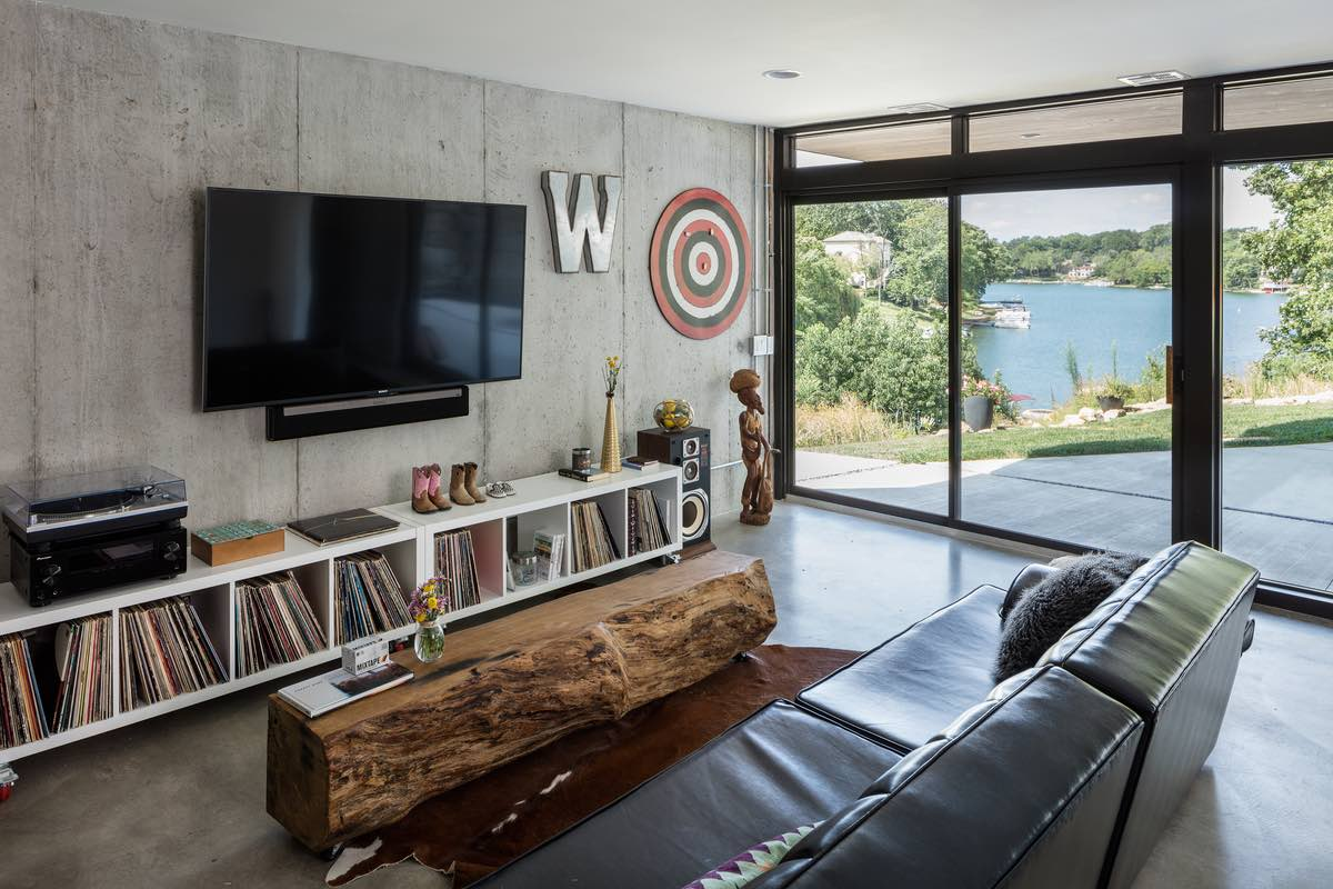 black leather sofa and Wooden table located in living room