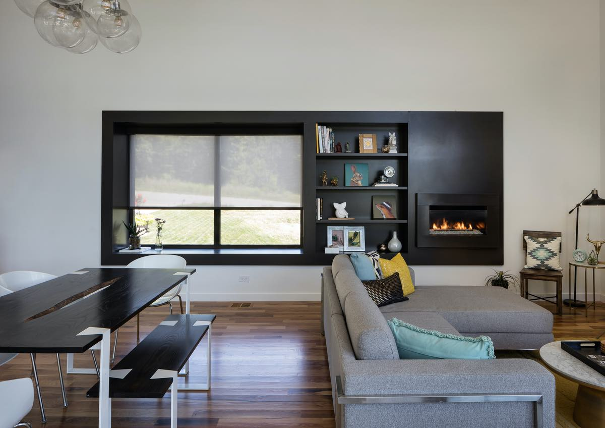 black chimney and bookshelves are in the living area