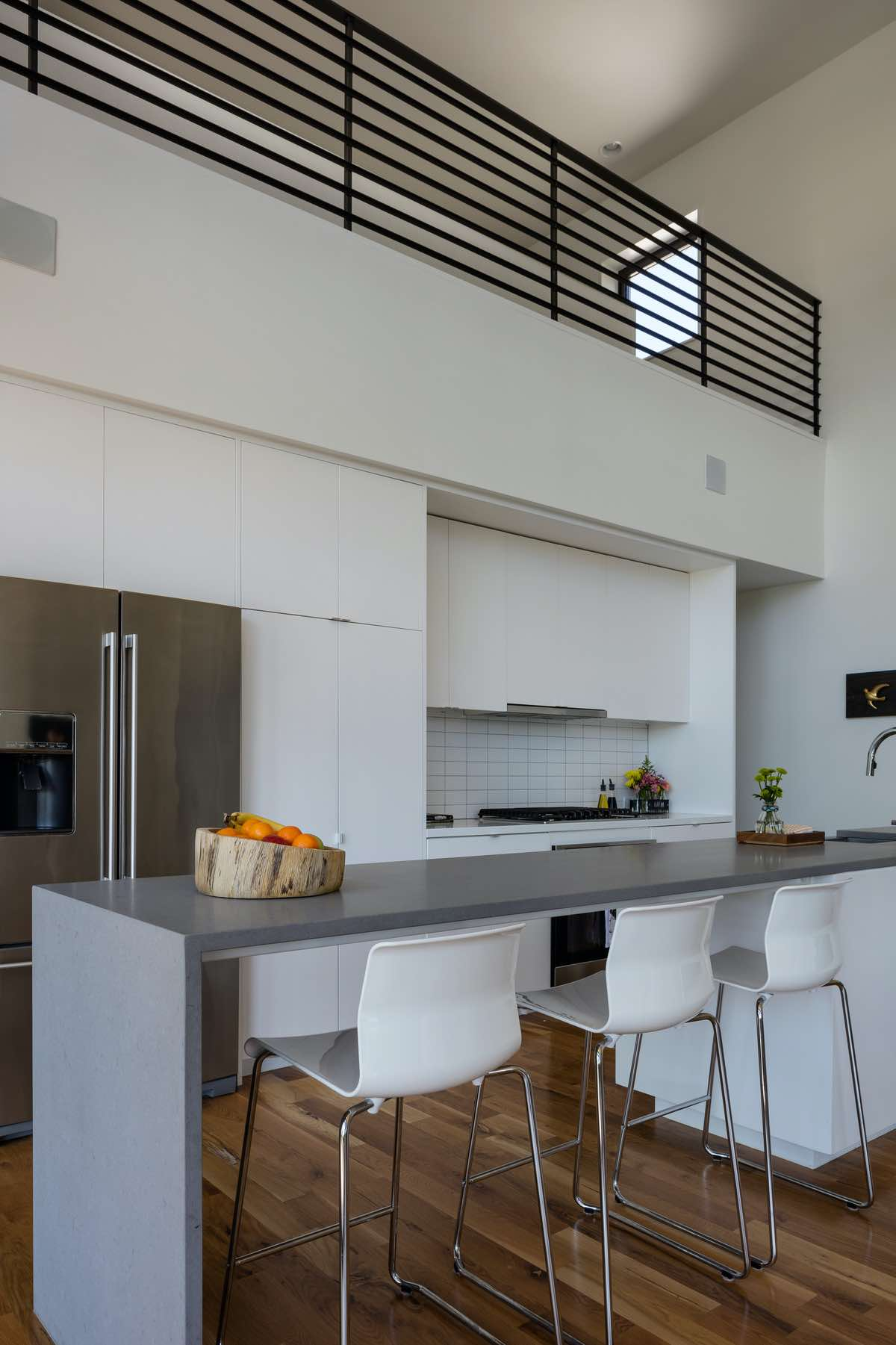 modern white bar stools in the kitchen area