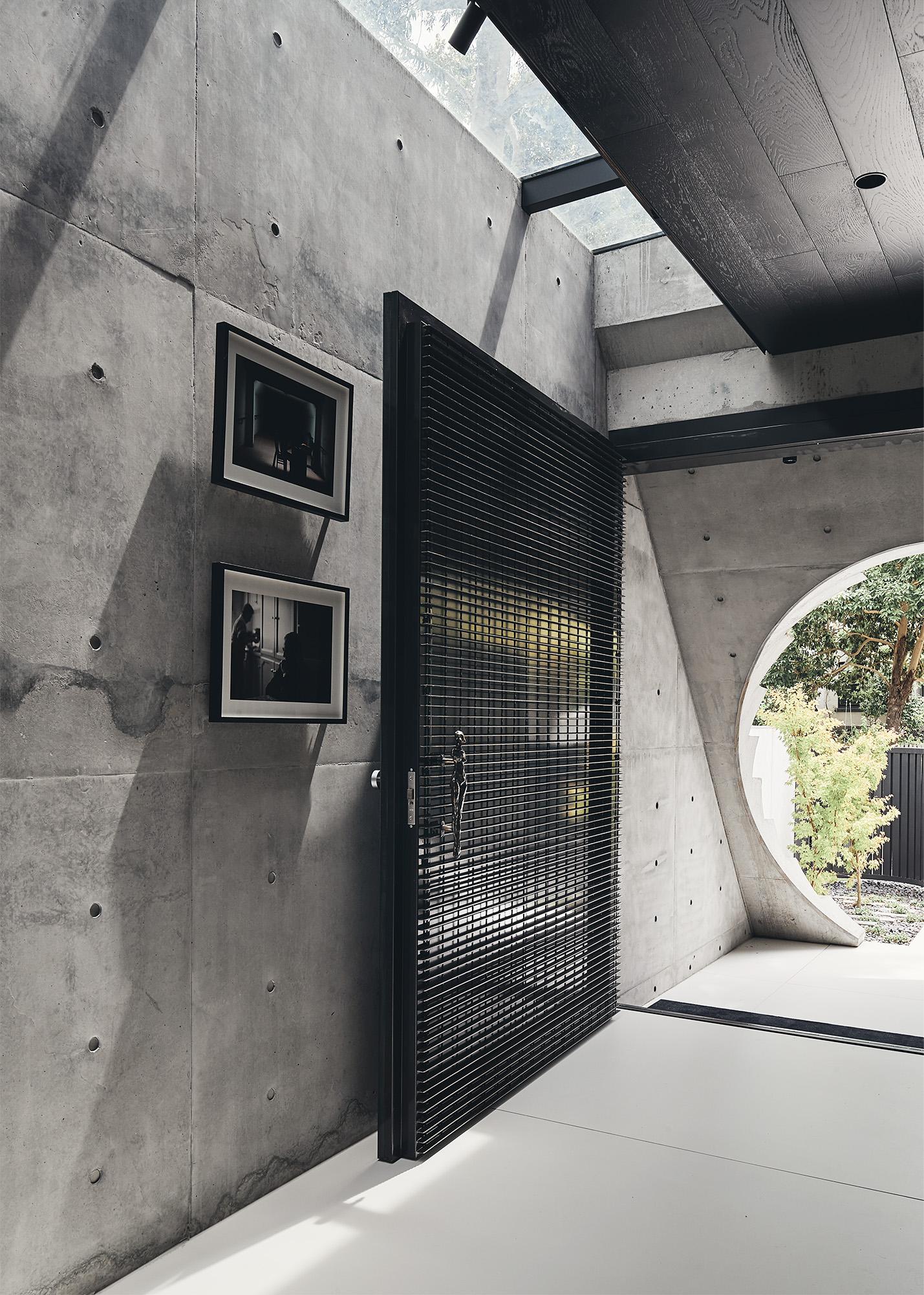 black metallic entrance door and skylight over the corridor