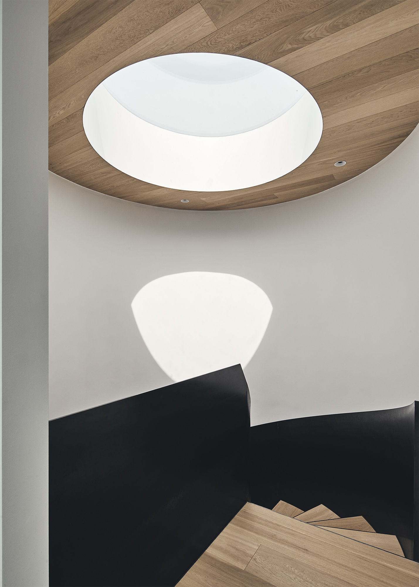 the circular hole in the ceiling let the sunlight enters the house