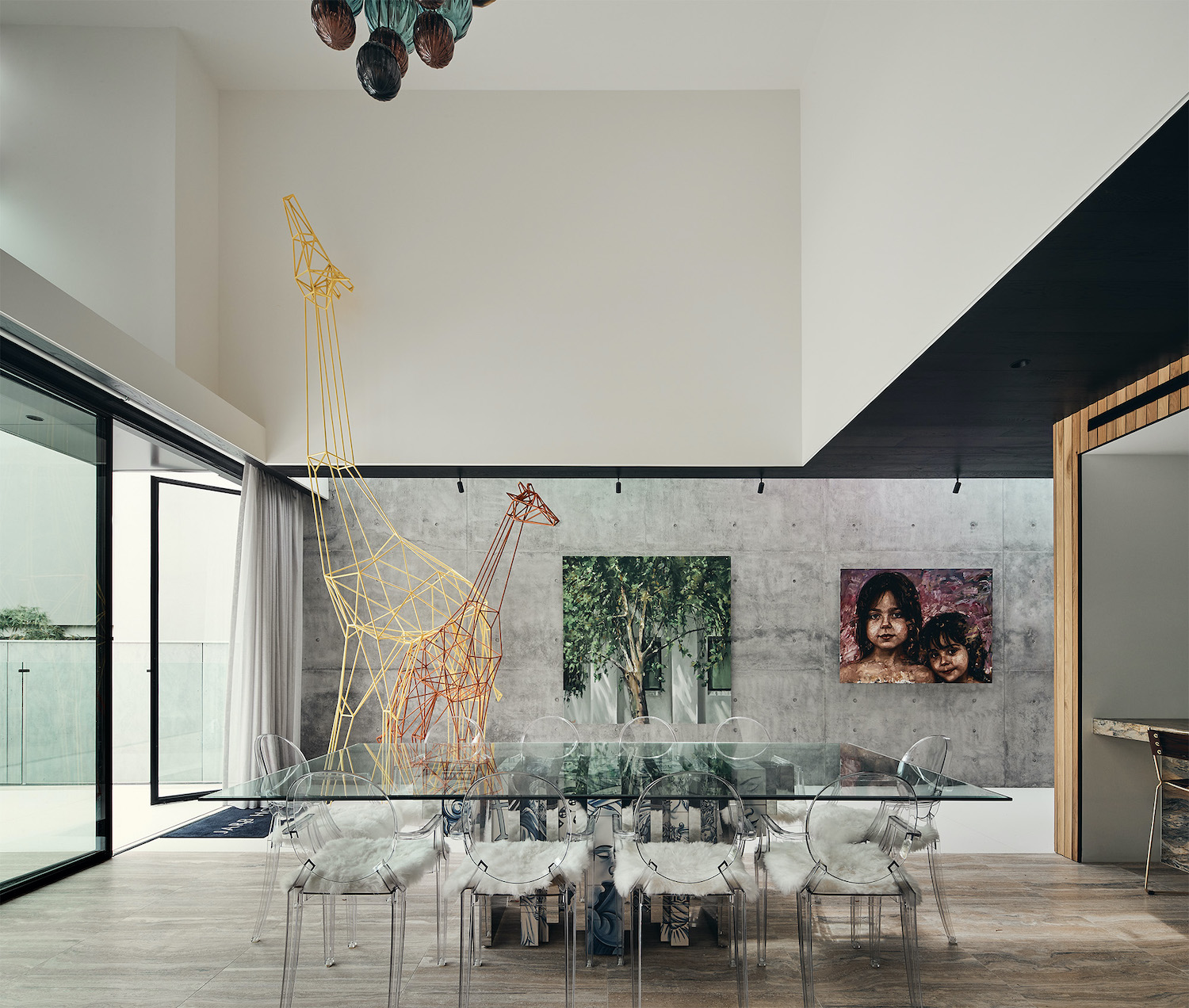 glass chairs with glass table at dining area