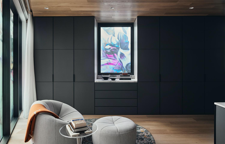 modern black wardrobe and armchair