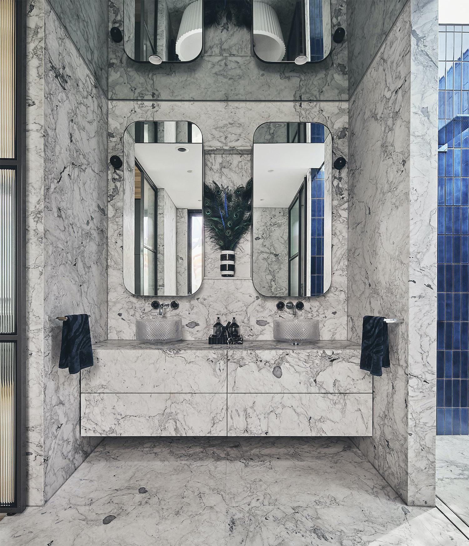 bathroom with marble walls