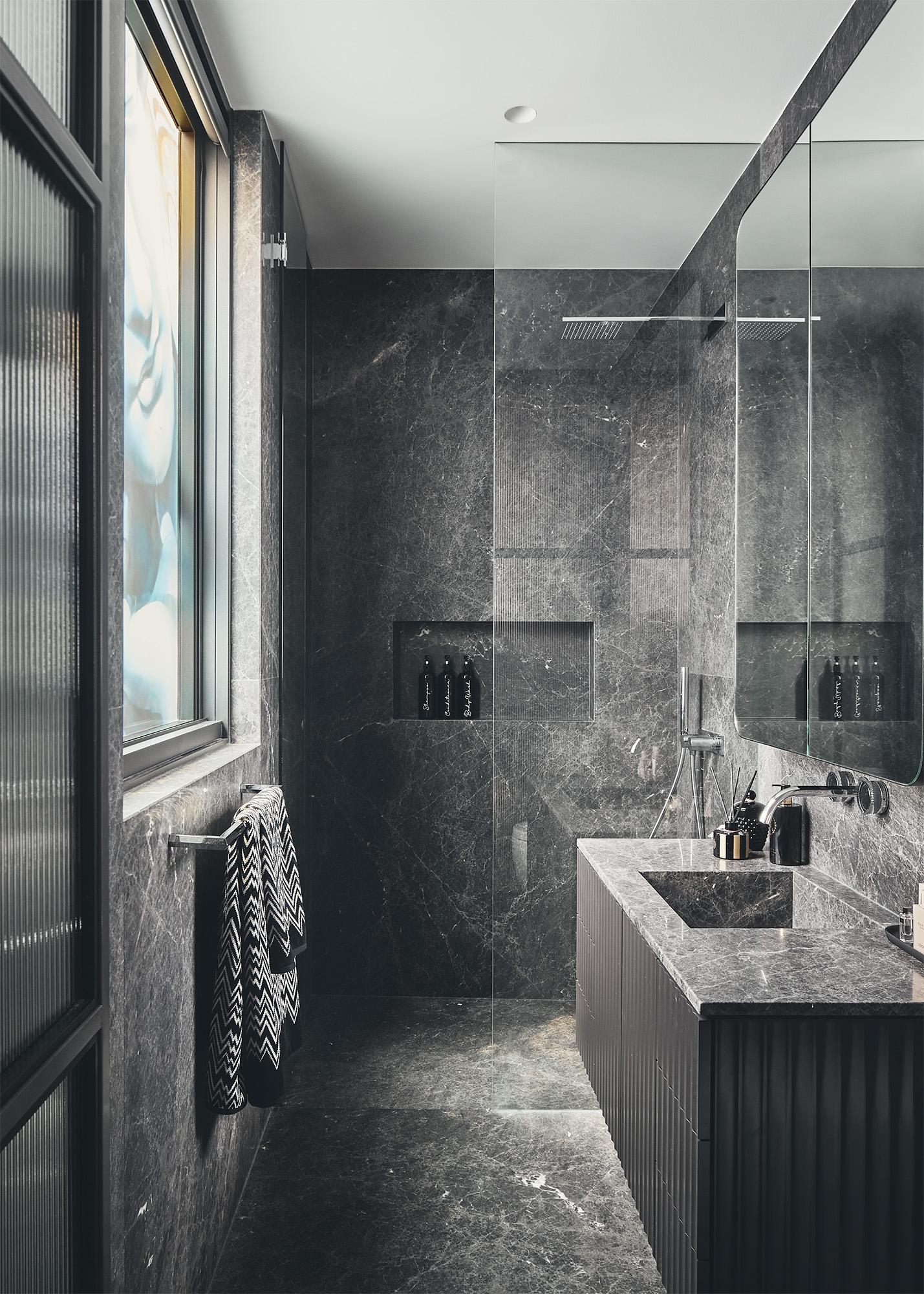luxury bathroom with black ceramic walls