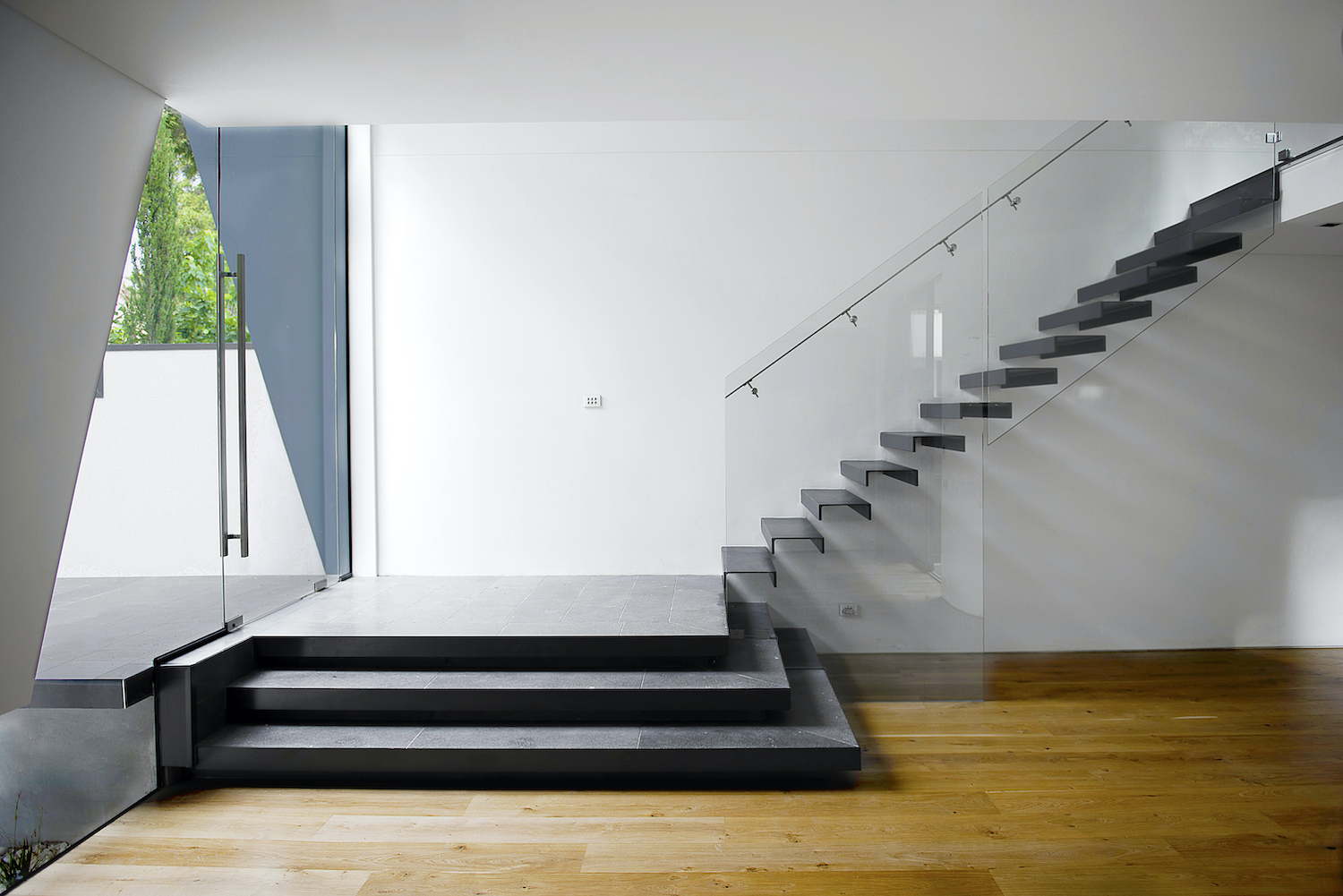 black staircase at the entrance glass door