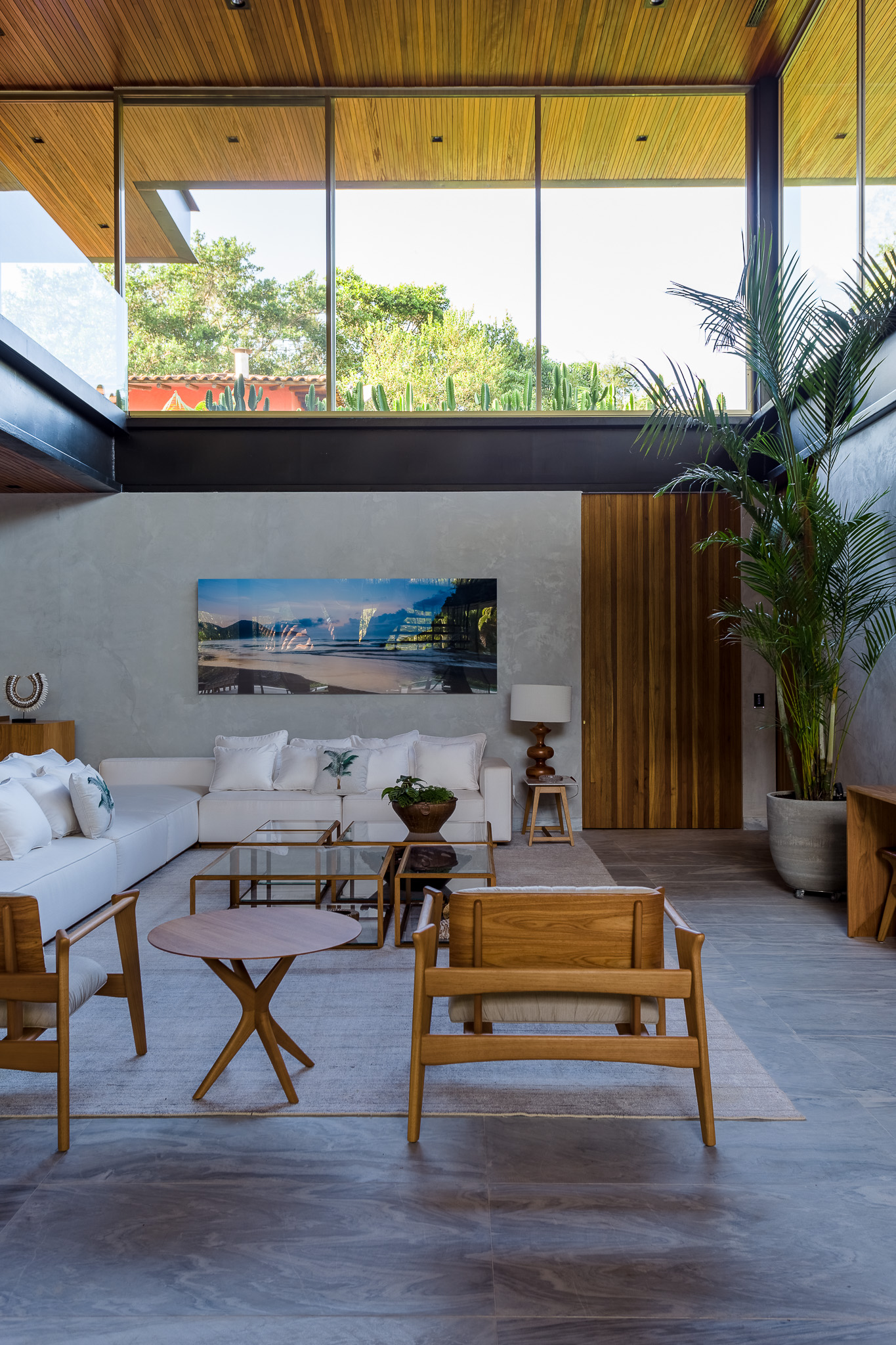 living space with white sofa and painting on the wall