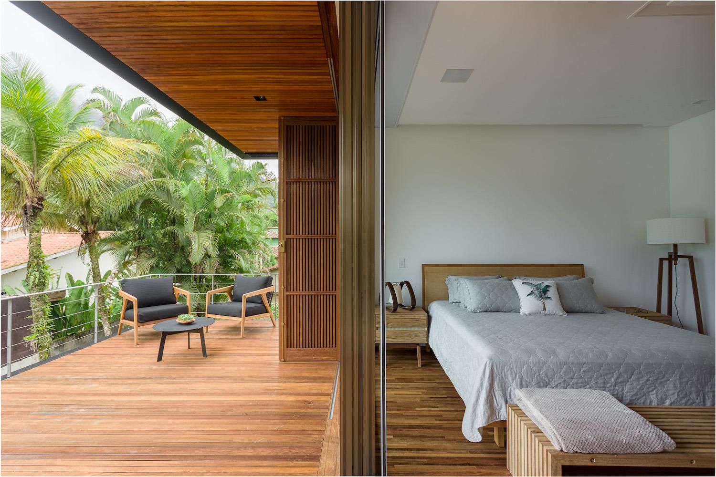 bedroom with open window to terrace