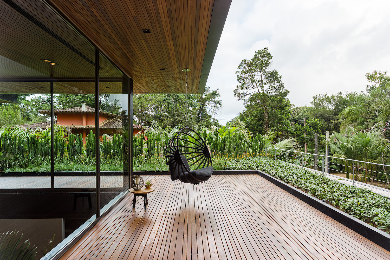 metalic hammock hanged to ceiling in terrace