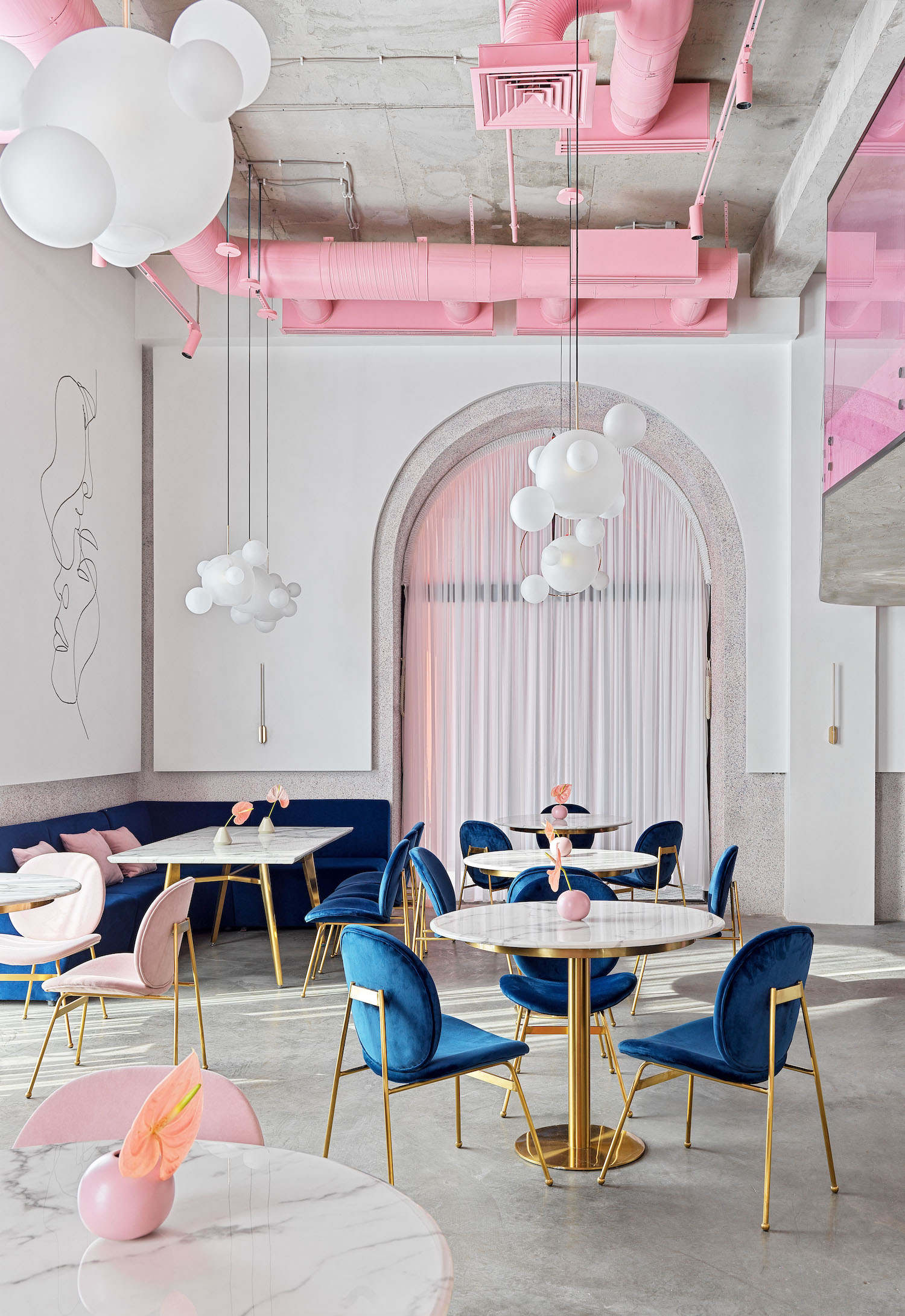 blue and pink chairs in dijon restaurant