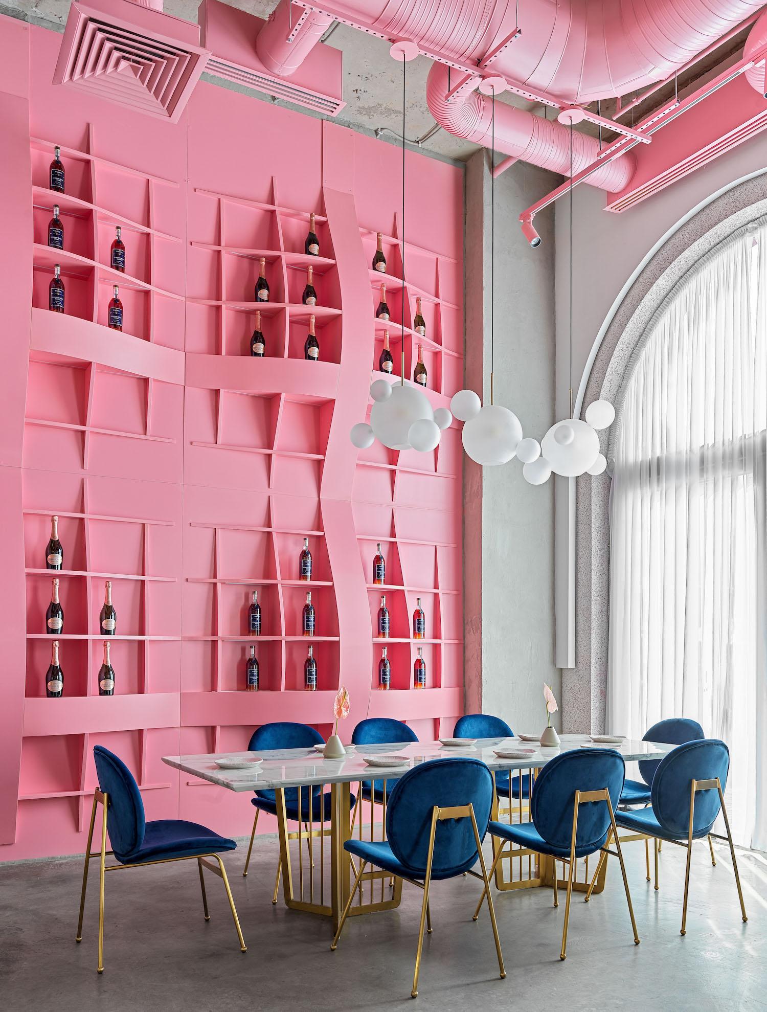 restaurant dining table near the pink shelves