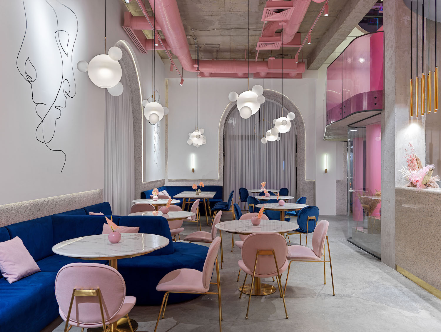 pink chairs and blue sofa in restaurant