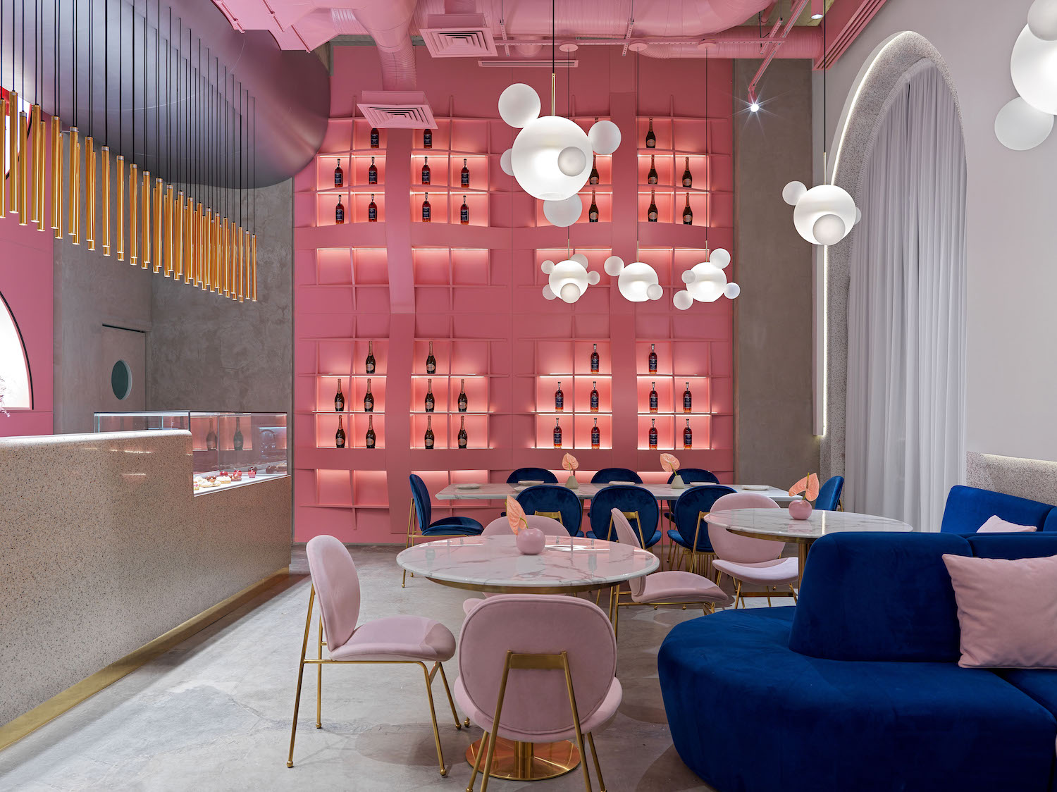 restaurant with bar and pink shelves